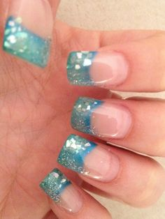 My own nails with gel nail art.  Blues & greens blended together with silver glitter and bits of pearl shell