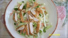 Applebee s Oriental Chicken Salad from Food.com: This recipe is from top secret recipes. This actually tastes like the salad from applebees. It is a bit of work, but worth every second!!