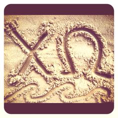 Chi Omega in the sand