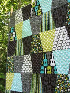Modern and Funky Tumbler Quilt Baby or Lap Size Groovy Guitar Fabric. $130.00, via Etsy.