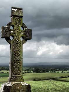 https://flic.kr/p/PZkK4S | Celtic Cross | Rock of Cashel, Ireland.  A Celtic cross is a symbol that combines a cross with a ring surrounding the intersection. In the Celtic Christian world it was combined with the Christian cross and this design was often used for high crosses – a free-standing cross made of stone and often richly decorated.  #Megalithic & Statues #Colour #Photography  www.richardsugden.com  © Richard Sugden 2016 All rights reserved.