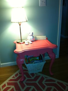 Cute table to have by the glider.  Start looking at garage sales for one to paint!