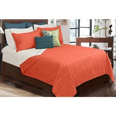 (in blue) Add bright colors and lovely textures to your house with accessories and furnishings from Colour Your Home. This quilt set includes a quilt and two matching-color pillow shams. Face is 100% polyester microfiber, fill is 50% polyester/50% cotton.