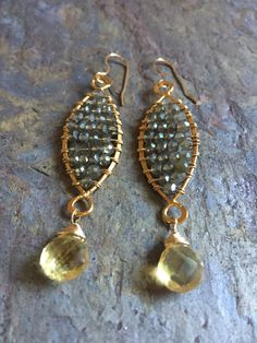 A personal favorite from my Etsy shop https://www.etsy.com/listing/483172555/gold-filled-hoop-statement-earrings-with