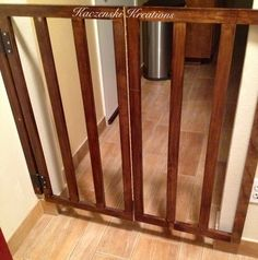 Homemade doggie or baby gate :) nicer looking and built in :)     K.Kreations-Homemade,Repurposed and refinished items.Creations available to rent for weddings & events.From lighting to drapery to homemade dance floors.Other items not event related(home design/re-modeling,projects) can be done/made to order.Upcoming website in the works.