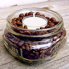 DIY coffee-scented candles: pour beans into a small glass jar and nestle a vanilla tealight inside