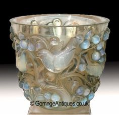 R. Lalique opalescent Avalon vase circa 1927, the moulded body with relief decoration of birds and cherry blossoms, base wheel etched R. Lalique and No. 986.