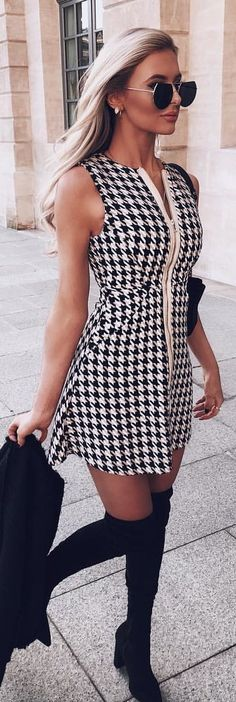 #winter #outfits white and black hounds-tooth printed sleeveless mid dress. Pic by @missellie_o.