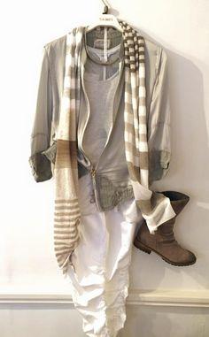 Charli vest £31.00 Elisa Cavaletti jacket £149.95 Elisa Cavaletti trousers £119.95 Elisa Cavaletti scarf £95.00 Choker £35.00 Cara boots £139.00