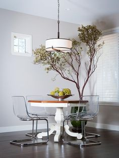 A great mix of flora, a vintage table and modern chairs!