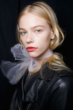 Grosgrain ribbon, strip tulle...wrap it around your neck without bothering to move your hair. See it tucked in the ribbon