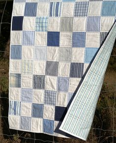 Shirts baby quilt....a great way to use up the scraps!  This is very cute!