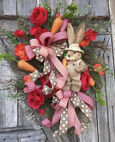 PETER COTTONTAIL~ Bunny Wreath Dainty florals, poppies in bloom, an assortment of lush greens and carrots.
