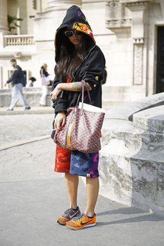 This girl is wearing alot. Nike Flyknit #sneakers Bape and Goyard bag. #fashion #streetwear