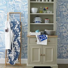 Kitchen with pale blue patterned wallpaper