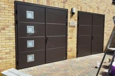 Garage doors with a personal touch Custom made garage doors: side hinged, sectional, sliding. Side Hinged Garage Doors, Garage Door Hinges, Garage Door Panels, Garage Door Design, Sliding Doors, Door Stays, Old Garage, Wood Images, Steel Windows