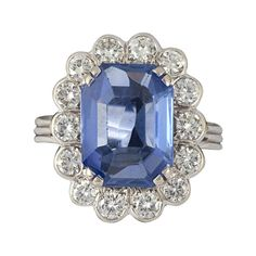 Sapphire, diamond and gold cluster ring | From a unique collection of vintage more rings at http://www.1stdibs.com/jewelry/rings/more-rings/