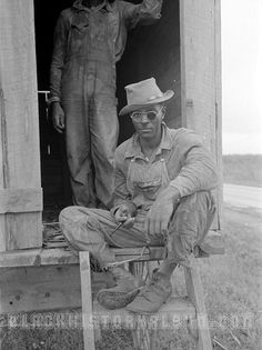 African American migrant worker sitting outside of a wagon parked in a sugarcane field somewhere in Louisiana. 1938