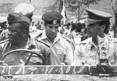 Synonymous with terrorism: A young Gaddafi, right, is seen in an undated photo
