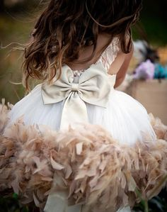 Who can resist a feather Boa? This girl's dress is beautiful and a great idea. Boa's can be added to any dress bottom! #Kid Style