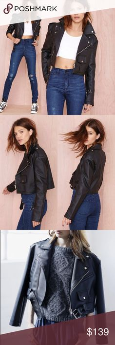 Six Crisp Days Rebel Vegan Leather Moto Jacket This is the piece you'll be reaching for every single day. It's a black faux leather jacket featuring faux pockets at front, zip closures, silver button detailing, and a belted waist. Super soft faux fur removable collar. Button tabs at shoulders, fully lined. Throw it on over your fave vintage tee, perfectly distressed cutoffs, and moto boots. PU Leather/Polyester. Runs true to size. No trades Nasty Gal Jackets & Coats
