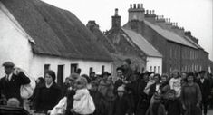 A column of Irish refugees fleeing the ruins of their homes following the Sack of Balbriggan by the British Occupation Forces during the Irish War of Independence, Ireland, 1920