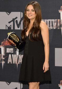 Baby bump alert! Mila Kunis attended the MTV Movie Awards without fiancé Ashton Kutcher last night, but she wasn't completely alone. Clad in a cute little black dress, this mark's the stunning star's second public appearance since news of her pregnancy broke last month. Though the dress mostly concealed her stomach, it was a departure from the go-to streamlined gowns she typically wears for red carpets. After all, a girl needs to make room for two!