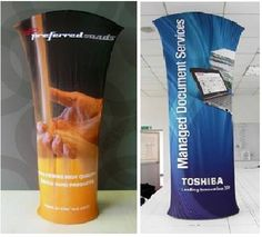 Double sided, printed banner stands, 10 lbs, $500.    http://www.american-image.com/trade-show-displays/brandcusi.shtml