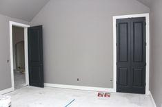 Gray walls, white trim, black doors by queen