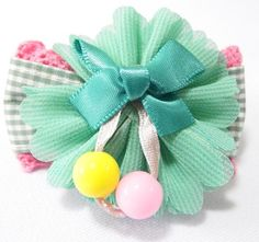 Ribbon Flower Hair Clip Green. 6cm (L) by 3cm (H). Ideal for children from 1 1/2 year old onwards. 1 for $2.00. Like us at https://www.facebook.com/pages/ChucklingBaby/675475065907287.