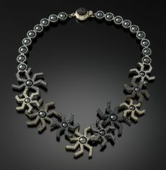 Starburst Necklace by Kathy King. Thousands of glass beads are hand-woven with nylon beading thread using Kathy's unique bead quilling technique. Glass pearls and a sterling silver clasp finish off the piece. Clasp may vary with each piece. Limited edition of 15
