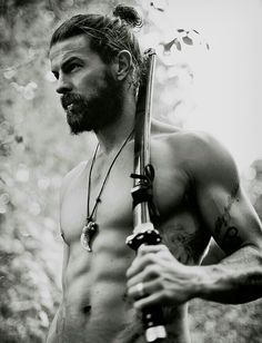 Beard. I know its crazy for you other girls but i like this pic for the beard,bun and sword kinda reminds me of samurai in a way. I had to crop it , he had pants it was just to revealing for a person like me. I would have took out more but some of the sword would be gone.