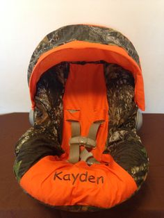 MOSSY OAK CAMO with orange Infant Car Seat Cover and Canopy with Free Monogram on Etsy, $55.00