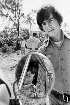 Beatles George Harrison and Ringo Starr circa 1965. Looks like this photo was taken when they were in the Bahamas filming their movie Help.