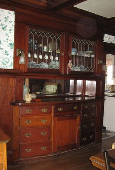 Dining Built-in in 1911 Craftsman bungalow in Portland, OR. The wallpaper was bad but the woodwork was totally amazing!