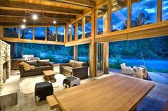 Large swivel doors make for a great indoor outdoor living and glass walls to bring in the lovely outdoors....Bamboo coverings block out light, 65% of heat, and prying eyes ;)