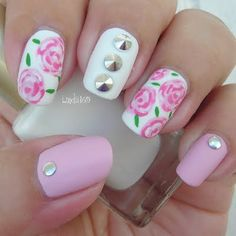 These gorgeous nails are all things girly, with pink and white nail polish with rose designs then matted down and add a touch of edgy studs to make it pop. DIY with the video tutorial here.