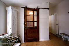 Create more private areas by mounting a door on a rail.