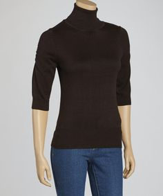Take on chilly days with a staple that's comfy cozy and totally chic. Three-quarter length sleeves and ruched shoulders bring modern detail to this tried and true classic.Measurements (size S): 22'' long from high point of shoulder to hem55% cotton / 45% rayonHand wash; hang dryImported