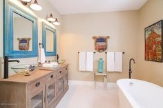 Love the vanity, mirrors,tub and wall color