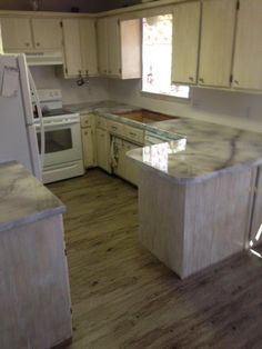 Our project of the week comes to us from our friend and local contractor, Ken Lazenby. Today's marbled kitchen countertop remodel involves DCI Smooth White Concrete Overlay, Pearl and Soft Gray Concrete Pigments and 100% Epoxy Countertop Sealer. He certainly got a beautiful finish on an existing countertop without all the cost or mess of a total replacement. That's working smart. Thanks, Ken!