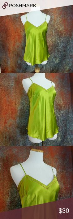 J. Crew 100% Silk Green Tank Top An exciting and lovely green tank perfect for summer. The accent stitching is pink. It is in great condition and without flaws. The straps measure 14 inches. J. Crew Tops Tank Tops