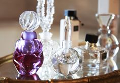 Make your perfumes a display piece by placing the beautiful bottles on a mirrored tray
