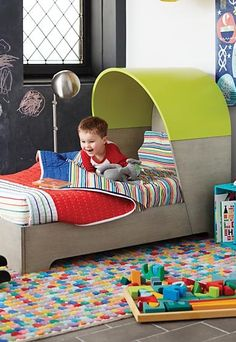From its stunning stained grey finish that allows the natural wood grain to show through, to its bold neon shelter headboard, every nook and cranny of our Nook Toddler Bed was crafted to be stylish.