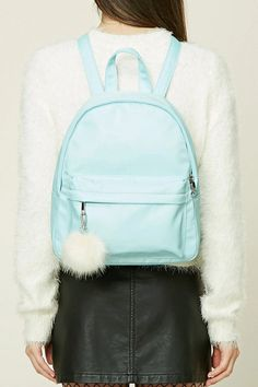 A large structured sheeny backpack featuring a high-polish zip front, front zip pocket with a pom pom clip, a top handle, interior patch pockets, and adjustable buckle straps.