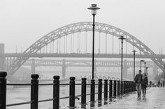 Newcastle-wedding-photography-walking-in-front-of- Tyne-Bridge-i