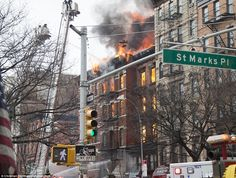 Terror: Flames can be seen coming out of two buildings on Second Avenue between 7th Street and St Marks Place. March 26, 2015