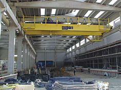 For the Shop, Bridge Crane 50-100 ton capacity main hoist, 10 ton auxiliary hoist, needs remote capability. I also like this shop layout with concrete construction.
