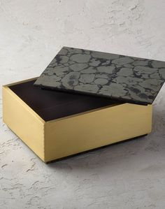 Function and style collide with this sleek, mixed-material box. This sophisticated design features a beautifully marbled pyrite lid and sides made of reinforced brass for added durability.