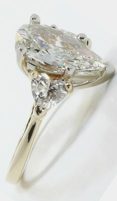 Pear perfection... with beautiful heart shaped side diamonds!